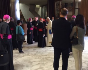 Pope Francis chats with bishops during day two of Synod on the Family.