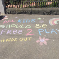 """Chalk writing on a pavement that says """"All kids should be free 2 play"""" #kidsout"""
