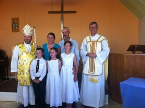 First Holy Communion in Tibooburra: Jill, Kim and Thomas Spiller with Mum Susan and Dad Les.