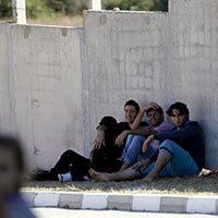 Refugees take a rest at a detention centre