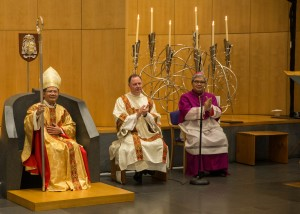 The moment Bishop Vincent Long was led by Archbishop Anthony Fisher OP to the Cathedra and presented with his Crozier