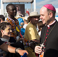 Bishop Michael Kennedy with Aussie pilgrims during World Youth Day, 2016.