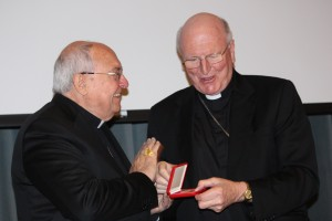 Cardinal Sandri presents Archbishop Hart with a special medal.